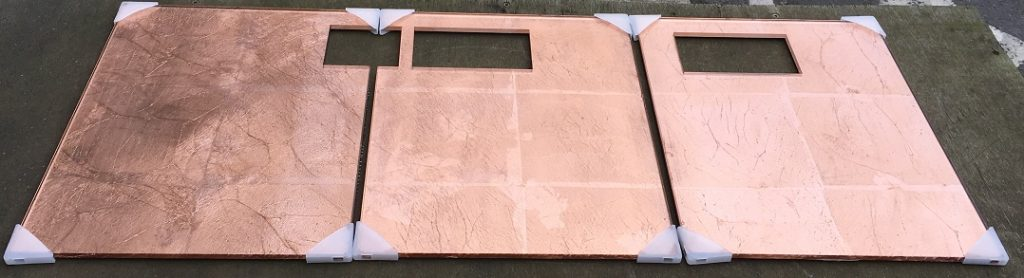 glass tiles with copper leaf waterjet cut for electrical sockets