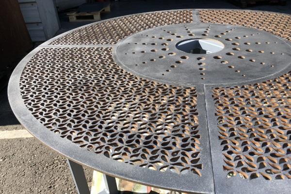 waterjet cut feature holes in corten steel fountain base 600 x 400