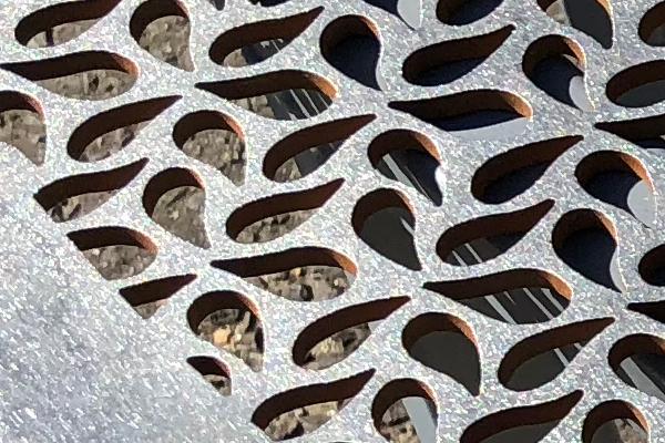 waterjet cut steel plate in close up detail