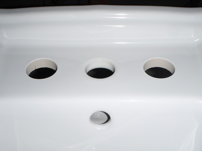 close up of water jet cut drilled holes in bidet