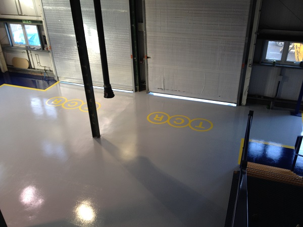 TCR company logo installed with yellow paint