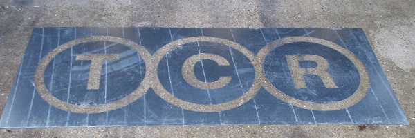 TCR company logo stencil in steel