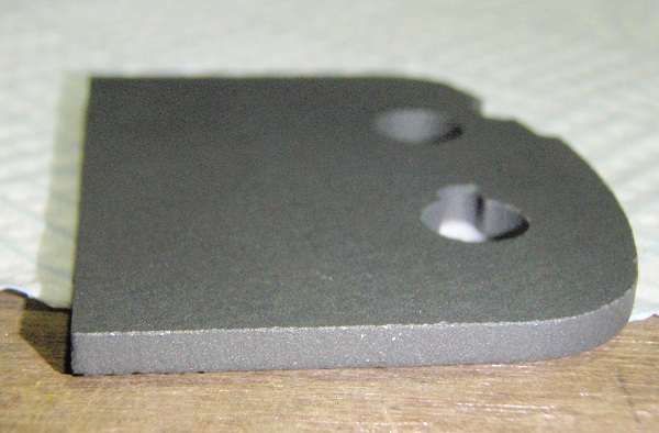 the cut edge of a 3mm thick ferrite part