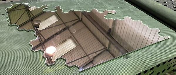 hexagonal pattern waterjet cut into a 6mm glass mirror
