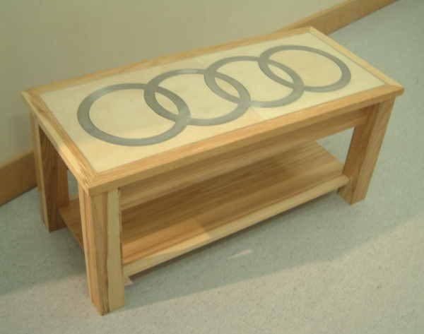 Audi logo set into coffee table