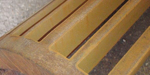 cast iron pipe section with strips waterjet cut from it
