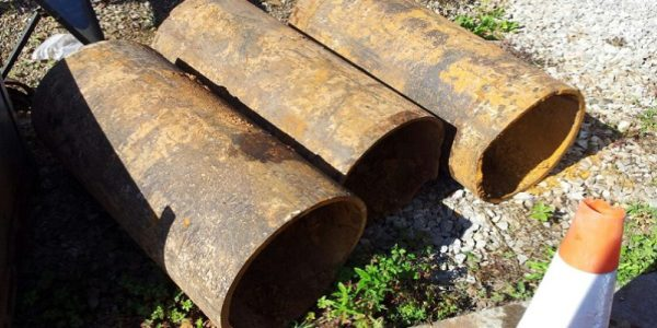 cast iron pipe sections as they were dug up from the ground